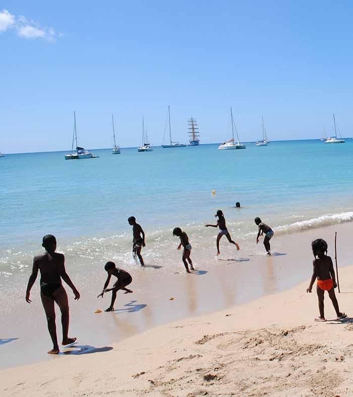 Children playing on beach, Rodney Bay, St. Lucia