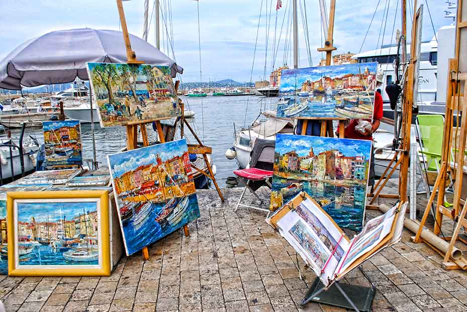 Artists on waterfront, St. Tropez, France