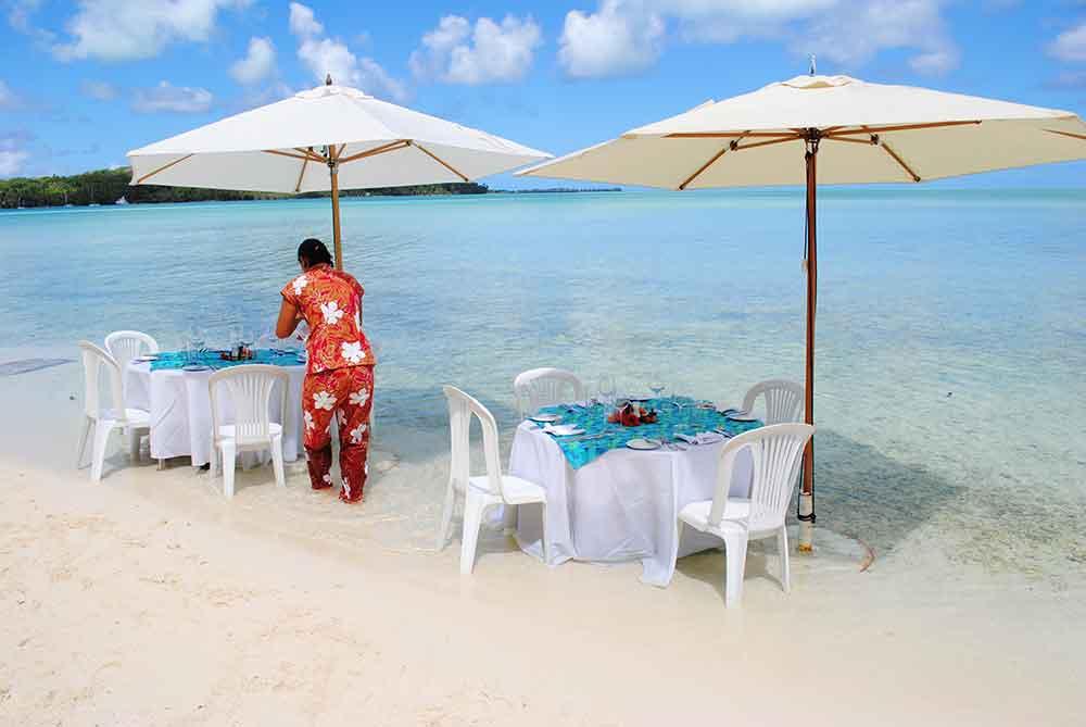 Tables at water's edge, Motu Tapu