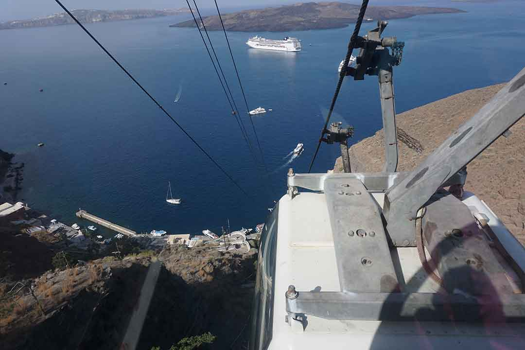 A three minute tram ride brings visitors from the shore to the town of Fira.