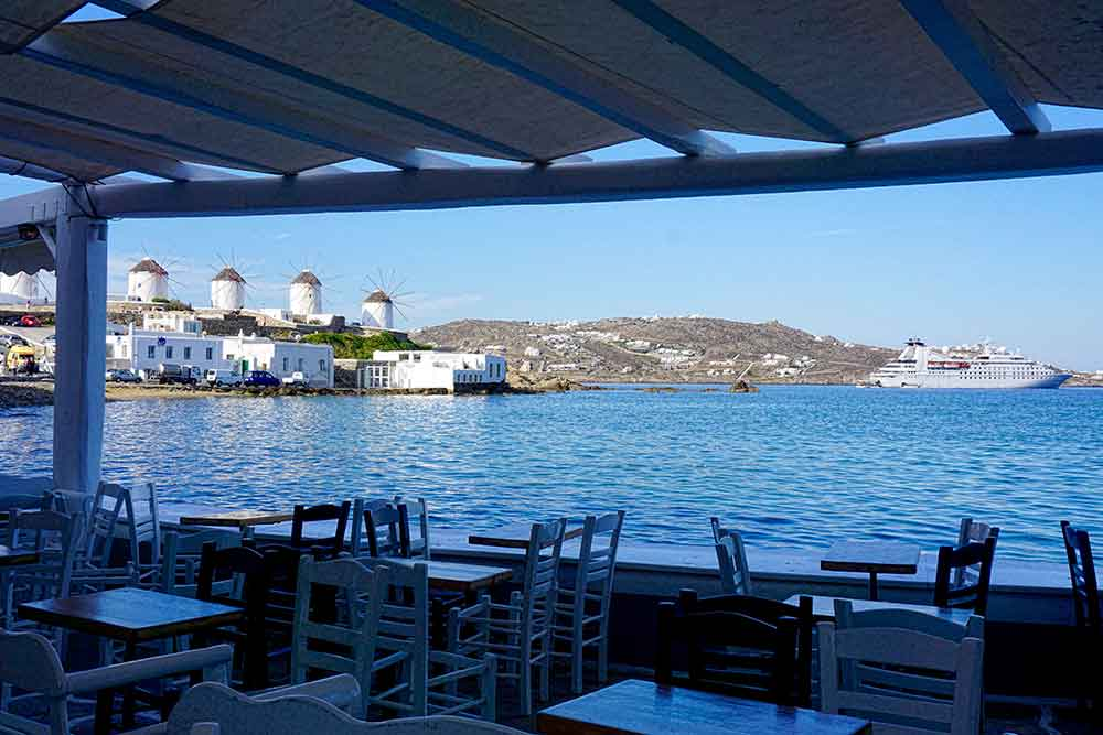 The thatched roof windmills of Mykonos with our ship in the distance.