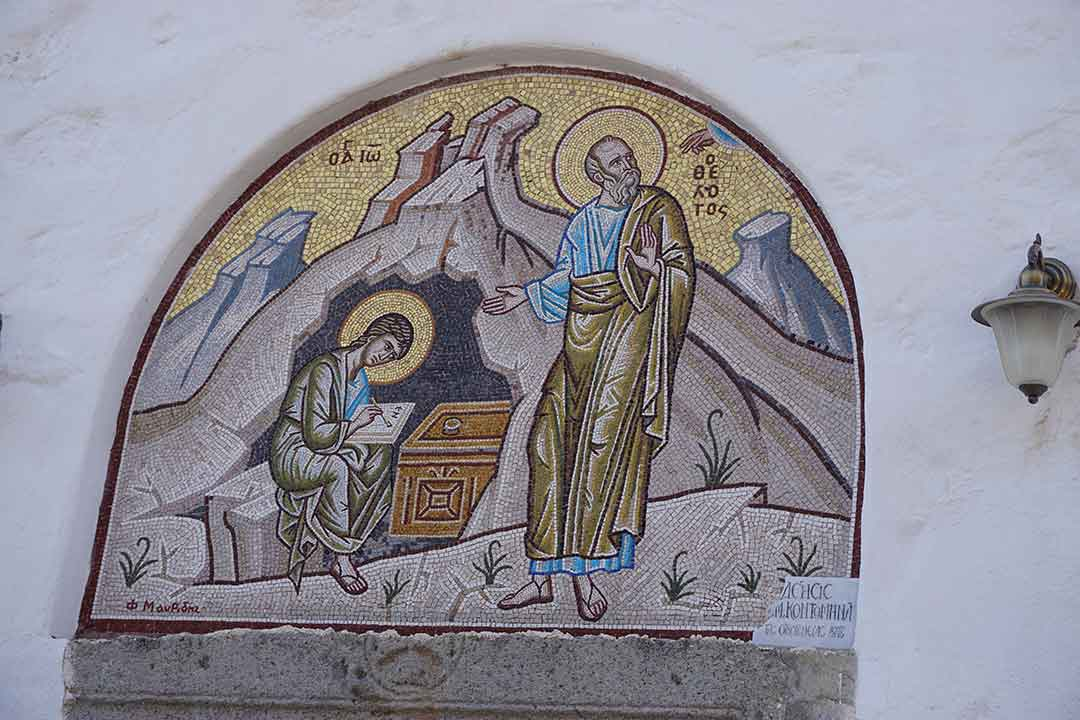 Ceramic mural at the entrance to the Cave of the Apocalypse, depicting John and his scribe in the cave.