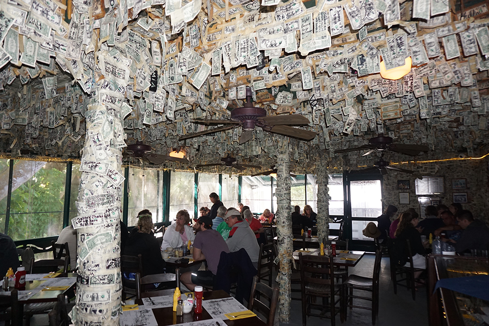 Inside the restaurant on Cabbage Key, autographed dollar bills cover the walls and ceiling.