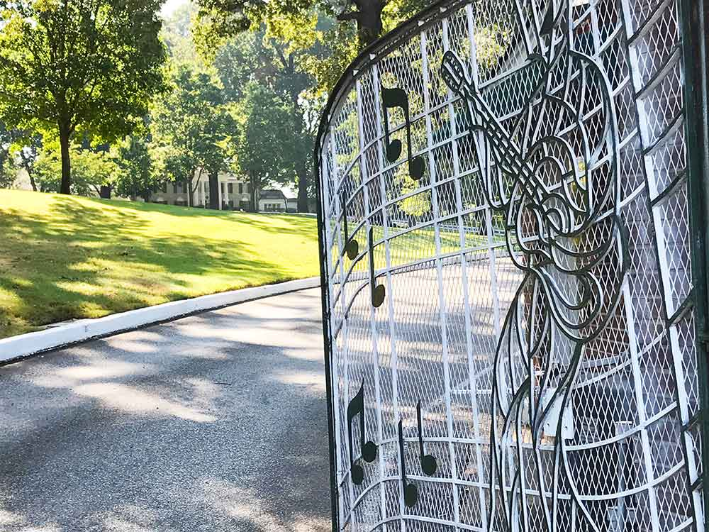 Looking up the driveway toward Graceland mansion from the musical gates.